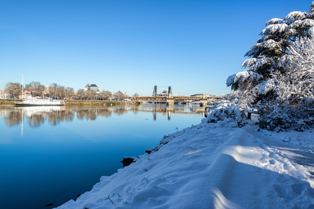 eastbank: Snow covered path in Portland, Oregon meandering along the Willamette River