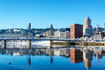 oregon  snow: Stunning view of Portland and the Hawthorne Bridge reflected in the Willamette River