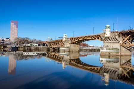 eastbank: Burnside bridge beautifully reflected in the Willamette River in Portland, Oregon