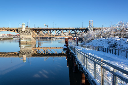 eastbank: PORTLAND, OR - JANUARY 12: Eastbank Esplanade in Portland, OR with the Moda Center in the background on January 12, 2017