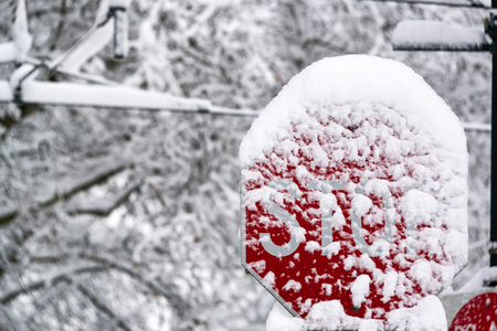 dumped: Stop sign in Portland, Oregon after a snowstorm dumped over a foot of snow on the city Stock Photo