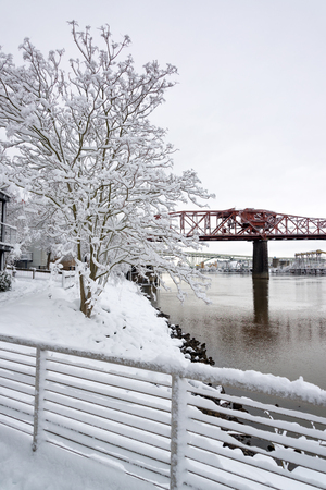 red america: Deep snow in Portland, Oregon with Broadway Bridge in the background