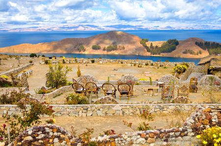 Chairs with a view of the Island of the Sun in Bolivia