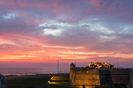 Historic defensive wall in Cartagena, Colombia with a stunningly beautiful sunset