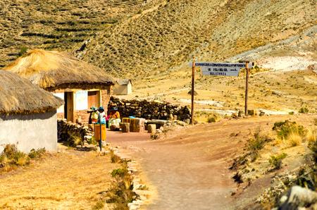 ISLA DEL SOL, BOLIVIA - AUGUST 18: Women selling tickets for tourists to enter Isla del Sol, Bolivia on August 18, 2014