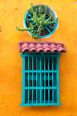 Colorful window on a historic colonial building in the center of Cartagena, Colombia