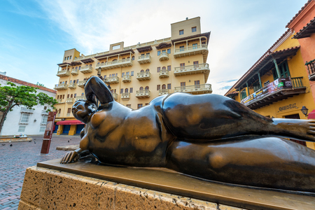 colonial church: CARTAGENA, COLOMBIA - MAY 25: Gertrudis statue by Colombian artist Fernando Botero in Santo Domingo Plaza in Cartagena, Colombia on May 25, 2016