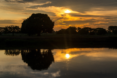 Dramatic sunrise over the Magdalena River in Mompox, Colombia Stock Photo