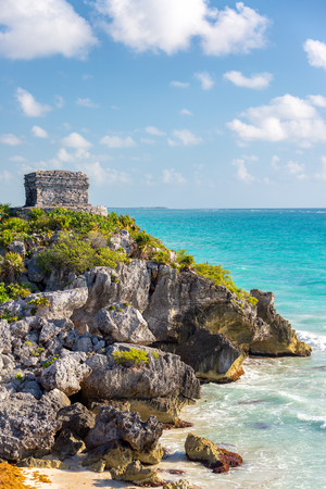 Ancient Mayan temple overlooking the Caribbean Sea in Tulum, Mexico
