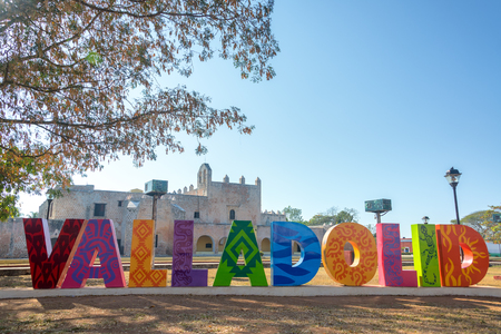 bernardino: Sign for Valladolid, Mexico with the Convent of San Bernardino in the background