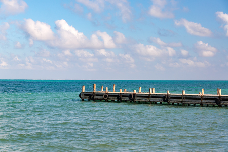View of a pier extending out into the Caribbean Sea in Punta Allen in the Sian Kaan Biosphere Reserve near Tulum, Mexico Stock Photo