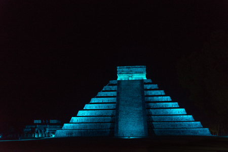 Night time view of El Castillo in Chichen Itza, Mexico bathed in blue light Stock Photo