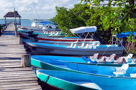 Boats lined up along a pier in Punta Allen near Tulum, Mexico
