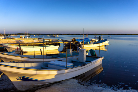 yucatan: Boats on the waterfront in the small town of Rio Lagartos, Mexico Stock Photo