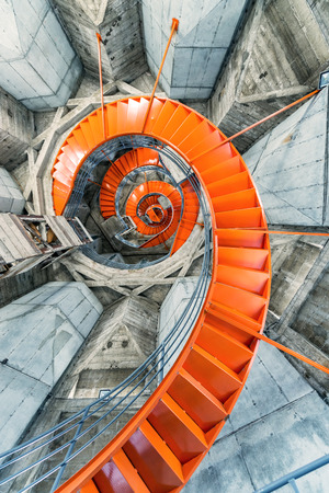 Orange spiral staircase inside the cathedral in Manizales, Colombia Imagens