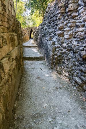 Narrow road passing through the Mayan ruins of Becan, Mexico