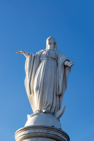 cristobal: Religious statue and blue sky on San Cristobal Hill in Santiago, Chile Stock Photo