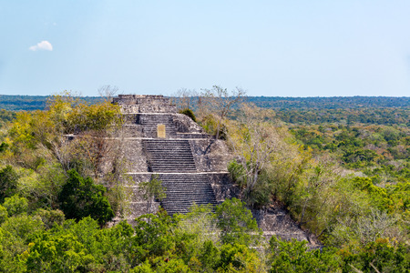 View of the pyramid known as structure one rising above the rain forest in Calakmul, Mexico