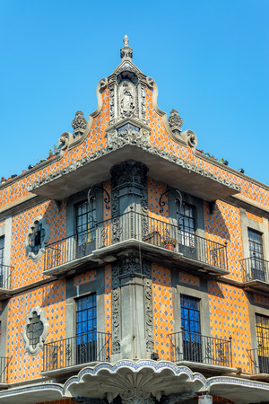 Colonial building covered in talavera pottery in historic Puebla, Mexico