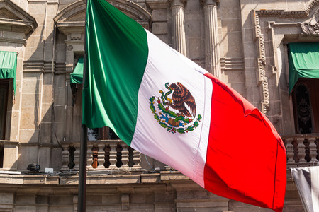 Mexican flag waving in front of the town hall in Puebla, Mexico