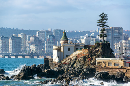 View of Wulff Castle with apartment buildings in the background in Vina del Mar, Chile