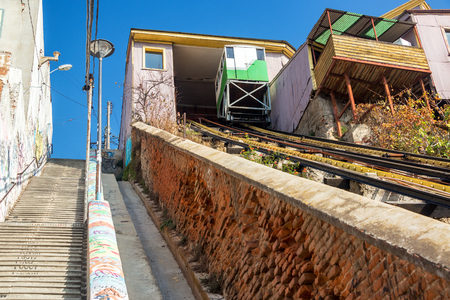 Stairs and a funicular railway going up a hill in Valparaiso, Chile Stock Photo