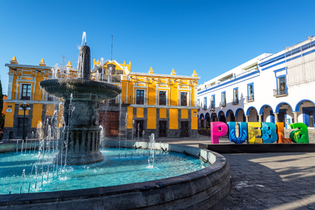 Fountain, theater, and Puebla sign in historic Puebla, Mexico