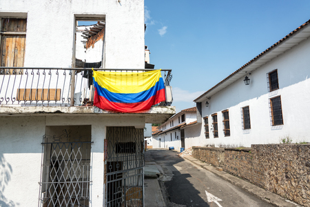 Colombian flag on a balcony in the center of Cali, Colombia