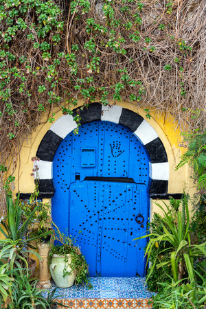 Ornate blue door in Sidi Bou Said, Tunisia with the hand of Fatima visible