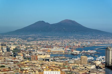 NAPLES, ITALY - APRIL 24: Cityscape view of Naples, Italy with Mt. Vesuvius rising in the background on April 24, 2018