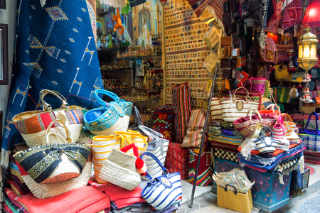 View of beautiful and colorful bags and rugs in the Medina in Tunis, Tunisia