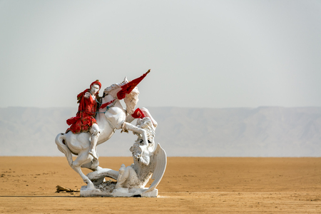Red and white statue in Chott el Djerid salt lake in the Sahara Desert in Tunisia