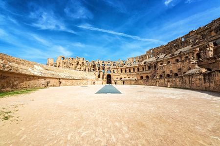View of the amphitheater of El Jem with a dramatic sky in Tunisia