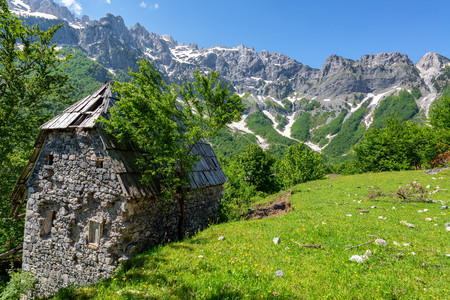 Old stone building in the village of Valbona in the Albanian Alps in Albania
