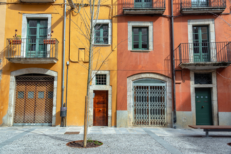 Yellow and red architecture in Girona, Spain Banco de Imagens