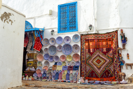 Variety of traditional souvenirs for sale on the street in Sidi Bou Said, Tunisia