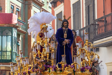 Ornate float featuring Jesus in a Holy Week procession in Seville, Spain