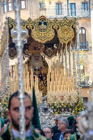 SEVILLE, SPAIN - MARCH 26: Crowd around a float of the Virgin Mary during Holy Week procession in Seville, Spain on March 26, 2018