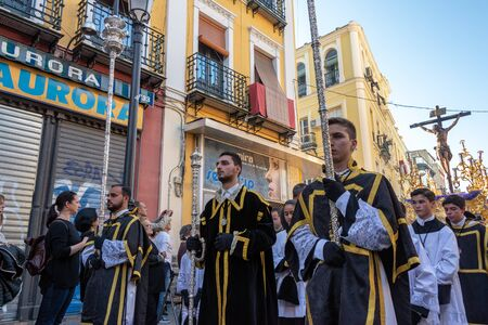SEVILLE, SPAIN - MARCH 27: View of a Holy Week procession passing by in Seville, Spain on March 27, 2018