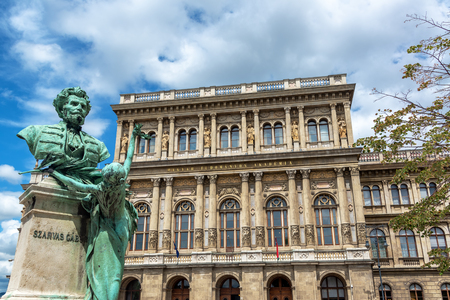 Bust of Gabor Szarvas and old historic architecture in Budapest, Hungary