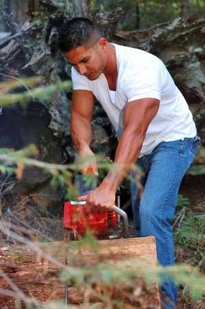 Image of male with chainsaw