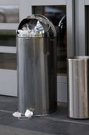 Image of garbage can with garbage spilling out Stock Photo
