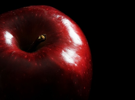 Close up image of an apple with black background