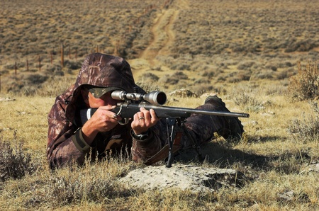 hunting rifle: Close up image of male shooting rifle Stock Photo