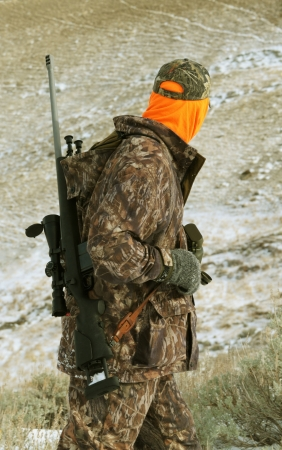 animals hunting: Isolated image of hunter with rifle Stock Photo