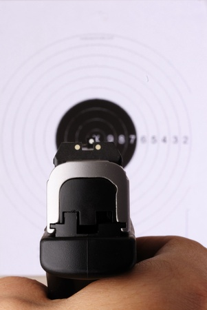 Close up isolated image of target practice.  Focuse on pistol. Stock Photo