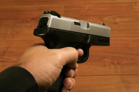 Close up isolated image of male holding pistol Stock Photo
