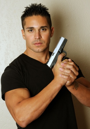 Isolated image of young male with firearm photo
