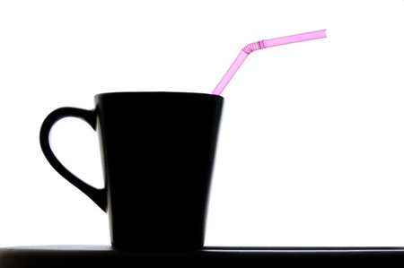 Close up isolated image of coffee cup with pink straw