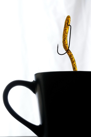Close up image of coffee cup with fishing lure